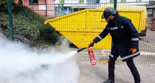 instructor demonstrating fire extinguisher